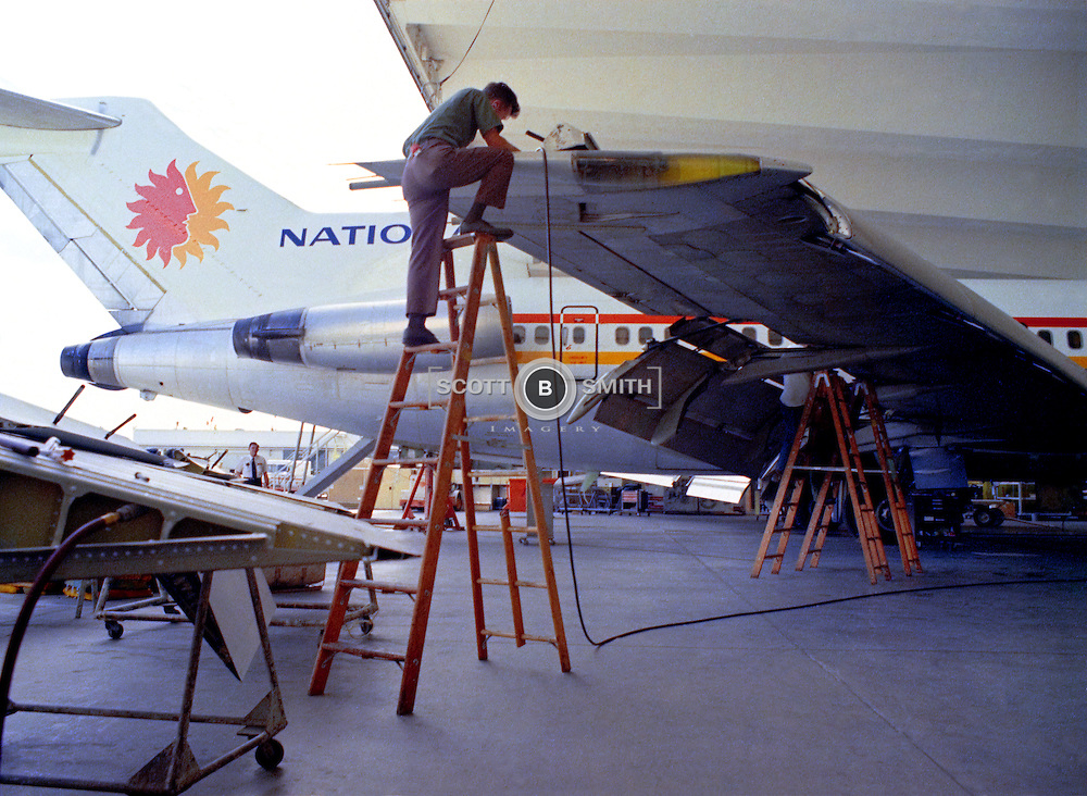 National Airlines Boeing 727 is worked on in their maintenance hanger, circa 1973