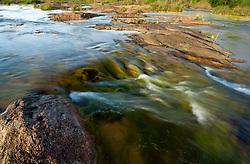 Stock photo of water flowing over rocks in the Llano River in the Texas Hill Country