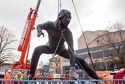 "© Licensed to London News Pictures. 18/03/2019. Plymouth, Devon, UK. ""Messenger"", the largest bronze sculpture ever to be cast in the UK, is transported through Plymouth city centre before being installed at the Theatre Royal in Plymouth City Centre. It was brought into Plymouth by barge across Plymouth Sound. Weighing in at nine and a half tonnes with a height of seven metres (23ft) and nine metres (30ft) wide, with a volume of 25.6 metres cubed, ""Messenger"" will be the size of two double decker buses and is the largest lost-wax cast bronze sculpture ever to be cast in the UK, a painstaking process that has taken over two years. ""Messenger"" is the work of the acclaimed sculptor Joseph Hillier and has been created using 3D scans from the body of a young actor in mid-performance in Theatre Royal Plymouth and Frantic Assembly's production of Othello in 2014. A monument to the physical expression of theatre, ""Messenger"" is a movement suspended in time that embodies the energy and creativity at the heart of the Theatre Royal and cultural life in Plymouth and aims to celebrate creativity as a dynamic catalyst for change. Plymouth is undergoing massive regeneration and the installation of the sculpture is is a prelude to the Mayflower 2020 celebrations. Messenger was cast at the Castle Fine Arts Foundry in the Welsh village of Llanrhaeadr-Ym-Mochnant, using the ancient technique of lost wax casting. Made from over 200 bronze panels, each section of the sculpture was cast individually before being welded together by over 30 master craftsmen at the foundry. Photo credit: Simon Chapman/LNP"