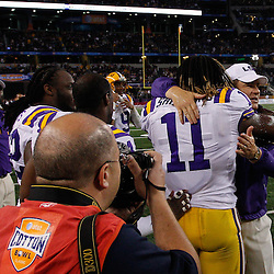 Jan 7, 2011; Arlington, TX, USA; LSU Tigers head coach Les Miles hugs linebacker Kelvin Sheppard (11)  following a win over the Texas A&M Aggies in the 2011 Cotton Bowl at Cowboys Stadium. LSU defeated Texas A&M 41-24.  Mandatory Credit: Derick E. Hingle