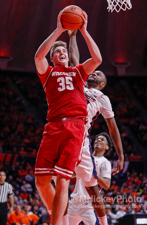 CHAMPAIGN, IL - JANUARY 23: Nate Reuvers #35 of the Wisconsin Badgers shoots the ball during the game against the Illinois Fighting Illini at State Farm Center on January 23, 2019 in Champaign, Illinois. (Photo by Michael Hickey/Getty Images) *** Local Caption *** Nate Reuvers