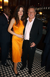 MR RICHARD NORTHCOTT and JOANNA KURPIERS at The Christmas Cracker - an evening i aid of the Starlight Children's Charity held at Frankies, Knightsbridge on 13th December 2006.<br /><br />NON EXCLUSIVE - WORLD RIGHTS