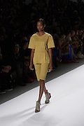 A mustard yellow short set by Richard Chai at the Spring 2013 Mercedes Benz Fashion Week show in New York.