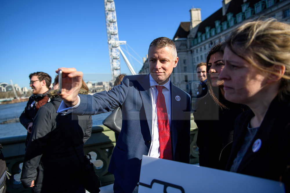 © Licensed to London News Pictures. 05/03/2019. London, UK.  MPs drop a banner reading Love Socialism Hate Brexit over Westminster Bridge and light red flares in a stunt which prompted police to clear the demonstrating members of parliament. MPs pictured on the bridge are:<br /> <br /> Clive Lewis,  <br /> Lloyd Russell Moyle,  <br /> Kate Osamor,  <br /> Marsha de Cordova, <br /> Sandy Martin, <br /> Alex Sobel,  <br /> Preet Gill,  <br /> Rachael Maskell,  <br /> Luke Pollard,  <br /> Chi Onwurah, <br /> Paul Sweeney,  <br /> Ged Killen, <br /> Rupa Huq,  <br /> <br /> Photo credit: Guilhem Baker/LNP