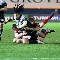 Rugby Union - 2017 / 2018 European Rugby Champions Cup: Scarlets vs. RC Toulonnaise<br /> <br /> Ma'a Nonu, of Toulon tackled by James Davies of Llanelli Scarlets  & Hadleigh Parkes of Llanelli Scarlets , at Parc y Scarlets, Llanelli.<br /> <br /> COLORSPORT/WINSTON BYNORTH