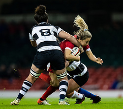 Elinor Snowsill of Wales under pressure from Charmaine McMenamin of Barbarians<br /> <br /> Photographer Simon King/Replay Images<br /> <br /> Friendly - Wales v Barbarians - Saturday 30th November 2019 - Principality Stadium - Cardiff<br /> <br /> World Copyright © Replay Images . All rights reserved. info@replayimages.co.uk - http://replayimages.co.uk