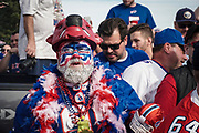 """SHOT 10/22/17 9:34:49 AM - A Buffalo Bills fan tailgating at the Hammer's Lot at the Pinto Ron tailgate party before the Buffalo Bills faced the Tampa Bay Buccaneers in Orchard Park, N.Y. Ken Johnson, better known as """"Pinto Ron"""", (born 1958) is a Buffalo Bills fan known for attending every single Bills home and away game and hosting a tailgate party since 1994. He is known for his red Ford Pinto and antics cooking food on his car hood in a variety of objects such as a shovel and army helmet; furthermore, he holds a tradition of being doused in ketchup and mustard. Most notably he served shots out of a bowling ball until he was forced to shut down by the National Football League (NFL) Johnson moved his tailgate party to private property next to the stadium where the NFL has no jurisdiction and was able to resume serving bowling ball shots. He has been featured in multiple NFL Films, as well as the made-for-TV movie Second String. (Photo by Marc Piscotty / © 2017)"""