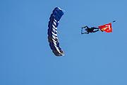 USA, Oregon, Hillsboro, USAF Academy skydiver, diving with the US Marine Corps Flag.