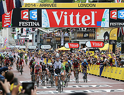 Image licensed to i-Images Picture Agency. 07/07/2014. London, United Kingdom. Marcel Kittel crosses the finishing line to win Stage 3 of the Tour de France in London. Picture by Stephen Lock / i-Images