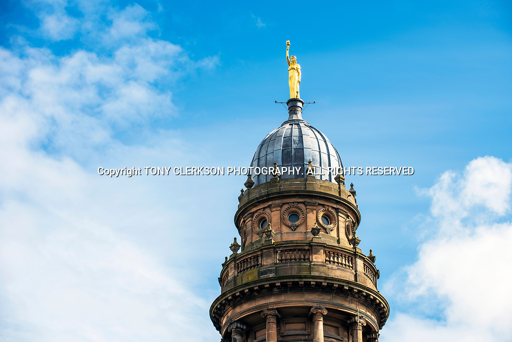 Kenny Mackay's Light and Life golden statue at the top of the Co-Op building in Tradeston, resplendent up in the sun