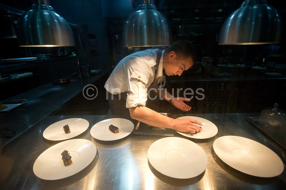 Food being prepared at Chef Paul Pairet's Ultra Violet (UV) restaurant in Shanghai, China on 28 September 2013. Serving only a dozen patrons per meal, UV is quickly making a reputation for itself as it combines the senses of taste, sound, and sight to the extreme.