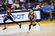 Golden State Warriors guard Stephen Curry (30) pushes the ball down the court against the LA Clippers at Oracle Arena in Oakland, California, on February 22, 2018. (Stan Olszewski/Special to S.F. Examiner)