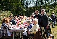"Approximately 130 guests joined together at the table for Sunday morning's ""Breakfast in the Orchard"" at Smith Orchard in Belmont served by Chef Halligan of Local Eatery and his crew.    (Karen Bobotas/for the Laconia Daily Sun)"