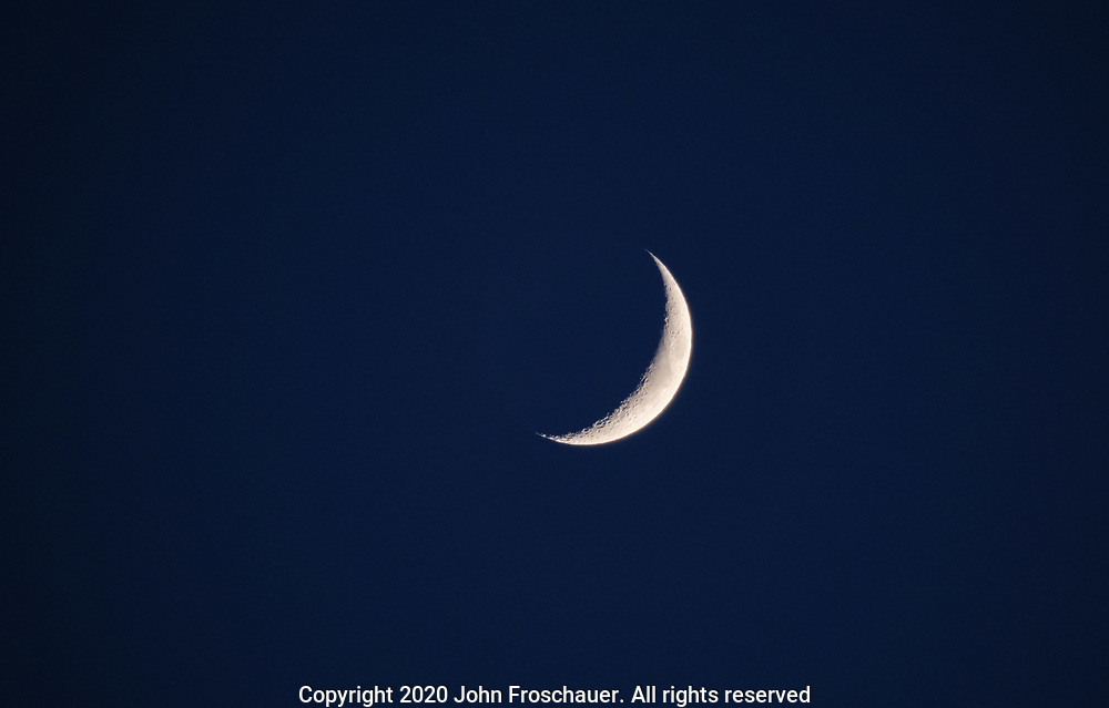 Crescent moon in the evening sky , Wednesday, June 24, 2020, in Tacoma. (Photo/John Froschauer)