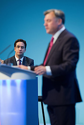 © Licensed to London News Pictures . 23/09/2013 . Brighton , UK . ED MILIBAND watches as Ed Balls , MP for Morley and Outwood and Shadow Chancellor of the Exchequer , addresses the conference this afternoon (Monday 23rd September 2013) . Day 2 of the Labour Party 's annual conference in Brighton . Photo credit : Joel Goodman/LNP