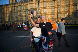 © Licensed to London News Pictures. 29/03/2019. London, UK. Brexit supporters are seen taking a selfie outside the Houses of Parliament, after MPs rejected Theresa May's withdrawal agreement. Photo credit: Ben Cawthra/LNP
