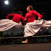 Cholita wrestler Martha La Altena (right) fights with a male wrestler dressed as a Cholita during the 'Titans of the Ring' wrestling group's Sunday performance at El Alto's Multifunctional Centre. Bolivia. The wrestling group includes the fighting Cholitas, a group of Indigenous Female Lucha Libra wrestlers who fight the men as well as each other for just a few dollars appearance money. El Alto, Bolivia, 11th April 2010. Photo Tim Clayton