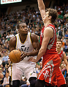 Utah Jazz forward Paul Millsap (24) goes up for a basket against Omer Asik (3) during the first half of the NBA game between the Jazz and the Houston Rockets in Energy Solutions Arena , Monday, Nov. 19, 2012.