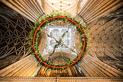 © Licensed to London News Pictures. 27/11/2015. York UK. One of the largest Advent wreaths in the country has been put in place at York Minster marking the start of the cathedral's Advent & Christmas festivities. The wreath measures 3 metres wide & holds five candles each 1 metre tall capable of burning constantly for three weeks. The candles represent the people who waited for the coming of Christ, with the fifth candle representing the birth of Christ. Photo credit: Andrew McCaren/LNP