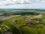 Nederland, Noord-Holland, Gemeente Schermer, 16-04-2012; Arismeer in de Noordeindermeerpolder met dorpje Driehuizen. Links het water van De Leie in de Eilandspolder (laagveen gebied, vaarpolder of vaarland), rechts De Schermer. Aan de horizon het Alkmaardermeer. .luchtfoto (toeslag), aerial photo (additional fee required);.copyright foto/photo Siebe Swart
