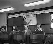 Prize Bonds Draw      (J26).1975..02.04.1975.04.02.1975.2nd April 1975..The first monthly draw held under the terms of the new prospectus of the prize bonds was held at the prize bond office, Bank of Ireland, 33-41 Lower Mount Street, Dublin..In this draw and future draws a new prize of £50,000 will will be drawn each month...Image shows the drawing of the first £50,000 prize bond. Each lady drew a different number from the drums..Miss Pauline Hester wrote the winning number on the display board.