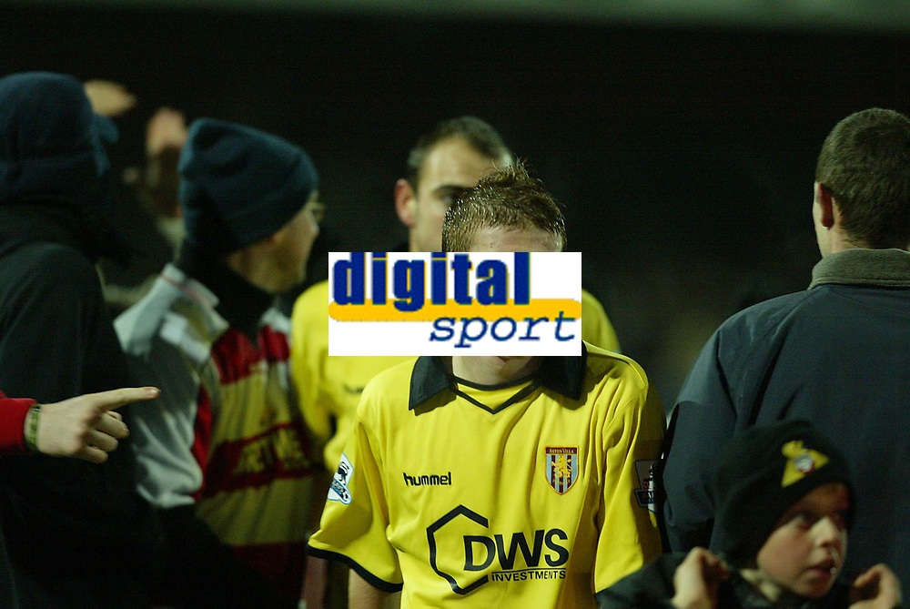 Photo: Aidan Ellis.<br /> Doncaster Rovers v Aston Villa. Carling Cup. 29/11/2005.<br /> Villa's Steven Davis trudges off at the end surrounded by Jubilant Doncaster fans