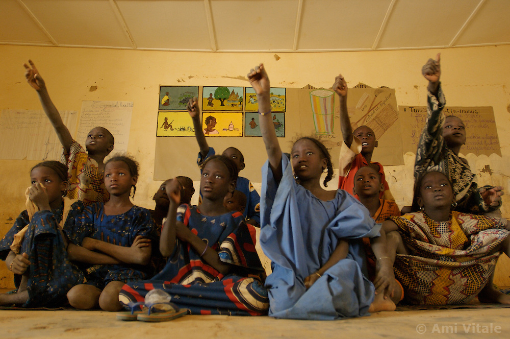 Children listen to their teacher in a classroom in the  village of Intedeyne March 16, 2007.  She had to drop out of school when she was married at the age of 14.  the challenge to educate children in Mali still exists and particularly for girls. Female literacy rates never reach even 50 percent of male literacy rates. Mali has the highest percentage of people living below the poverty line in any country in the world. Ninety percent of Malians survive on less than two dollars a day.