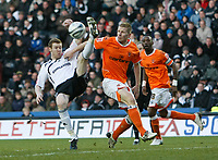 Photo: Steve Bond/Richard Lane Photography. Derby County v Blackpool. Coca-Cola Championship. 26/12/2009. Stephen Pearson (L) clears over Keith Southern (R)