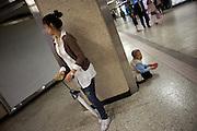 Bettelnde aeltere Frau in einer Passage der Metro in Seoul am Tag der Feierlichkeiten von Buddhas Geburtstag (2. Mai 2009) im Zentrum der koreanischen Metropole.<br /> <br /> Begging elderly woman in a passage of the Seoul metro on the day of the celebration of Buddhas birthday (2nd of May 2009) in the center of the Korean metropolis Seoul.