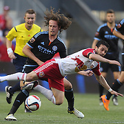 Mix Diskerud, (left), NYCFC, tackles Felipe Martins, New York Red Bulls, during the New York Red Bulls Vs NYCFC, MLS regular season match at Red Bull Arena, Harrison, New Jersey. USA. 10th May 2015. Photo Tim Clayton