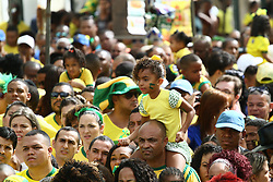 June 22, 2018 - Salvador, Brazil - SALVADOR, BA - 22.06.2018: TORCIDA DO BRASIL EM SALVADOR - Girl in the middle of the Olodum crowd in Pelourinho, in Salvador, Bahia, during a game between Brazil and Costa Rica, valid for the 2018 World Cup in Russia. (Credit Image: © Mauro Akin Nassor/Fotoarena via ZUMA Press)
