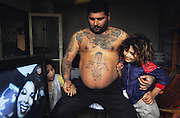 Roma family, man with tattoos. Living in Senica, Slovakia.