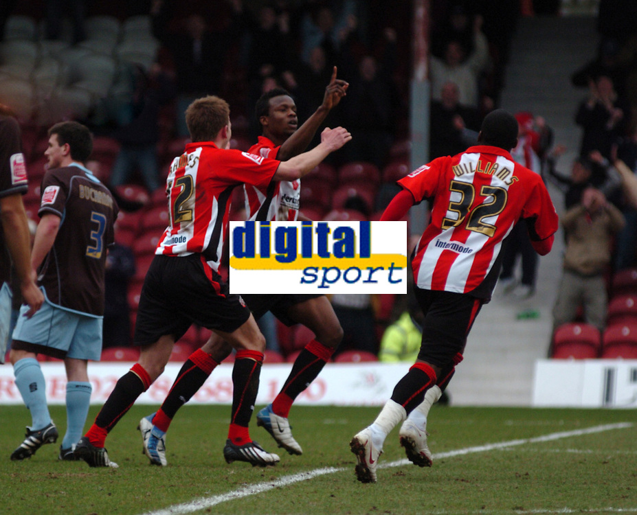 Photo: Tony Oudot/Richard Lane Photography. Brentford v Bury . Coca-Cola Football League Two. 28/02/2009. <br /> Marcus Bean of Brentford celebrates his goal with Jordan Rhodes and Marvin Williams after scoring the first goal