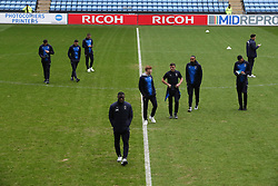 AFC Wimbledon players inspect the pitch after arriving at The Ricoh Arena ahead of their Sky Bet League One match against Coventry City.