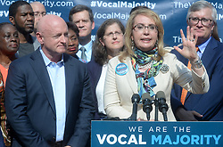 Gun violence victim and former U.S. Congresswoman Gabby Giffords, alongside her husband Mark Kelly, during a visit to City Hall on her 2016 Vocal Majority Tour on October 17, 2016 in New York City, NY, USA. Giffords, along with her husband NASA astronaut Mark Kelly, are on a six-week, nationwide bus tour to battleground states asking people to vote for candidates who support gun violence prevention legislation in this coming November election. The Vocal Majority Tour is a project of their national organization, Americans for Responsible Solutions PAC. Giffords, who has made a dramatic recovery, survived an assassination attempt in 2011 near Tucson, Arizona. Photo by Dennis Van Tine/ABACAPRESS.COM