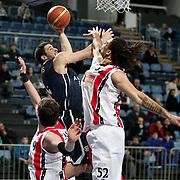 Anadolu Efes's Dogus Balbay (C) during their Turkish Basketball League match Anadolu Efes between Bandirma Kirmizi at Sinan Erdem Arena in Istanbul, Turkey, Saturday, December 24, 2011. Photo by TURKPIX