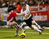 Photo: Chris Ratcliffe.<br /> Charlton Athletic v Liverpool. The Barclays Premiership. 08/02/2006.<br /> Xabi Alonso of Liverpool gets past Alexei Smertin