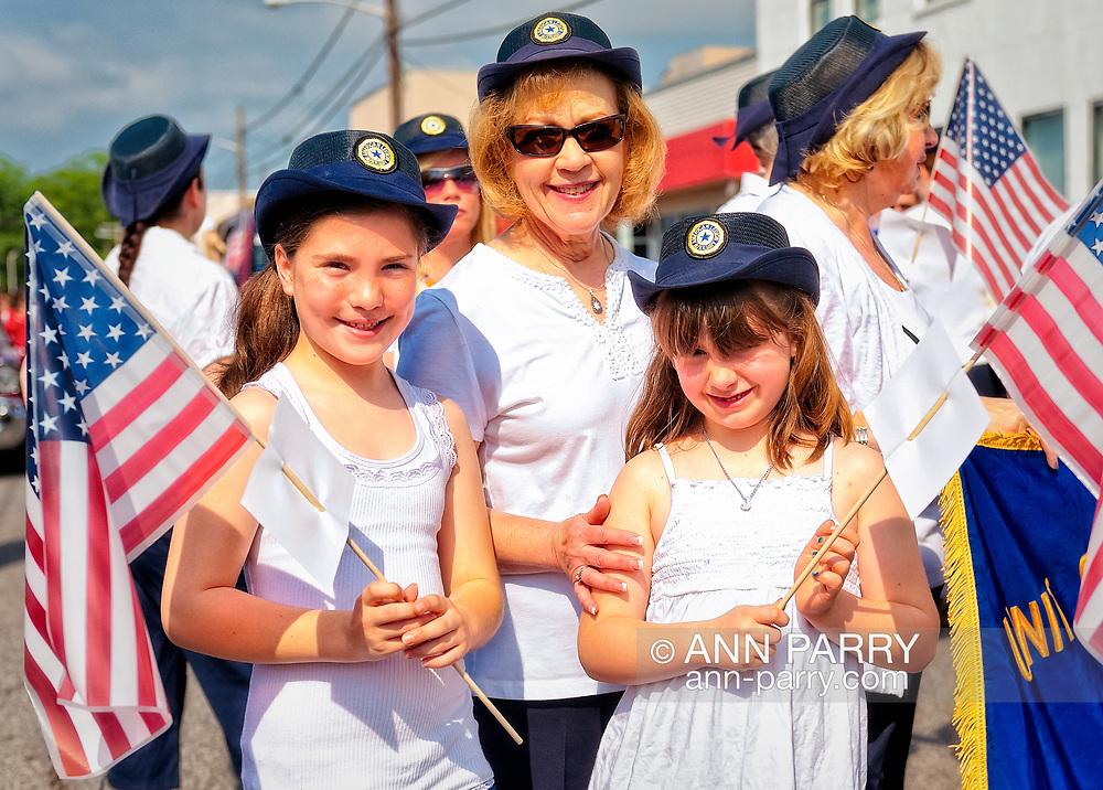 American Legion Auxiliary members SHARON WILLIAMS and her granddaughters MADISON and JACQUELINE are marching at Merrick Memorial Day Parade and Ceremony on May 28, 2012, on Long Island, New York, USA. Their Merrick Post 1282 hosted the parade and ceremony. America's war heroes are honored on this National Holiday.