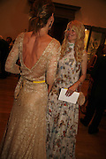 Trinny Woodall and Claudia Schiffer , Summer Exhibition preview party. Royal Academy. Piccadilly. London. 7 June 2006. ONE TIME USE ONLY - DO NOT ARCHIVE  © Copyright Photograph by Dafydd Jones 66 Stockwell Park Rd. London SW9 0DA Tel 020 7733 0108 www.dafjones.com