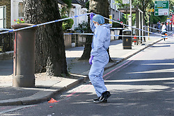 © Licensed to London News Pictures. 01/06/2019. London, UK. A forensic officer on Seven Sisters Road, near the junction of Vartry Road in Haringey, north London, where a man in his 30s was found suffering from a stab wound to his leg. Police were called by London Ambulance Service just after 3am on Saturday, 1 June 2019. The victims condition in unknown.  Photo credit: Dinendra Haria/LNP