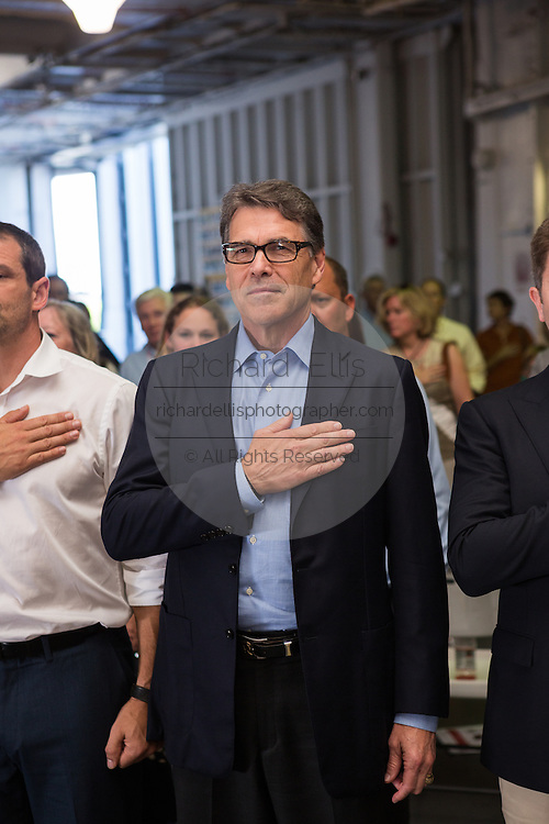 Former Texas Governor and GOP presidential hopeful Rick Perry stands for the pledge before a town hall campaign event aboard the USS Yorktown in Mount Pleasant, South Carolina.
