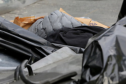 © Licensed to London News Pictures. 13/03/2019. London, UK. Victims clothing at the crime scene outside Leyton Underground tube station in East London where a 17 year old boy was stabbed multiple times at 12.45pm. According to the Met Police, the victim is in a life threatening condition.  Photo credit: Dinendra Haria/LNP