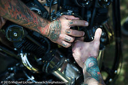 Working on Oliver Jones' bike with his Keiji Kawakita rocker boxes on Friday - for the builder-invite bike check-in for the Born-Free 6 Vintage Chopper and Classic Motorcycle Show. Silverado, CA. USA. June 27, 2014.  Photography ©2014 Michael Lichter.