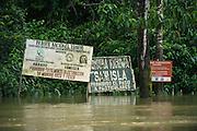 Community signs on Tiputini River bordering<br /> Yasuni National Park, Amazon Rainforest<br /> ECUADOR. South America