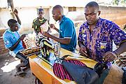 Mfaume Saidi, Hatibu Faraji, Haji Ally and Hamidu Saidi owners of Mnyangu Sofa Seat a local sofa making company, receiving assistance as part of the VSO / ICS Elimu Fursa project (Opportunities in Education) Lindi, Lindi region. Tanzania.