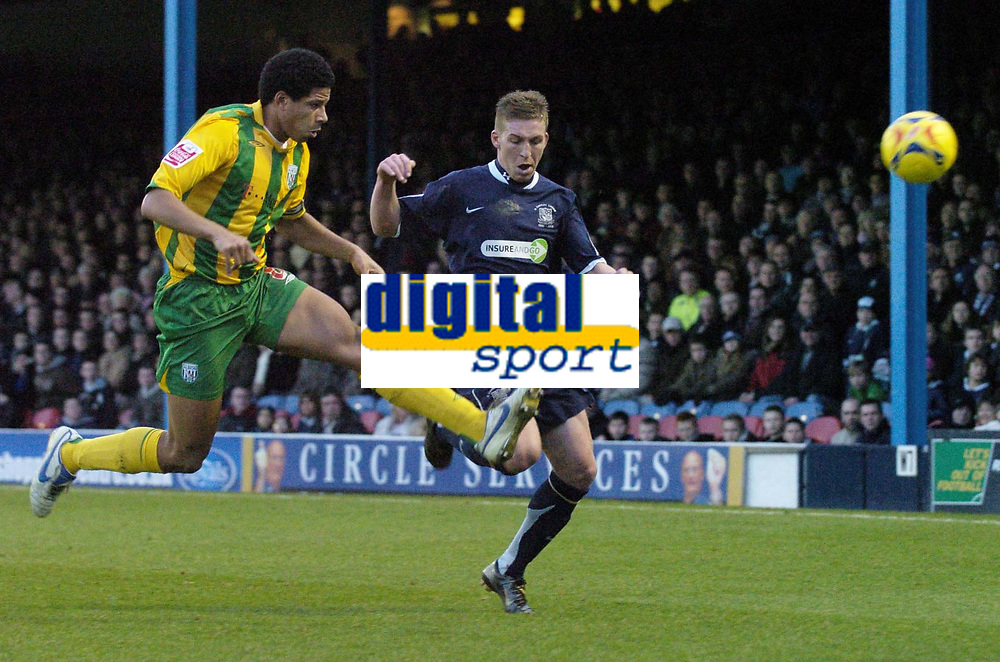 Photo: Olly Greenwood.<br />Southend United v West Bromwich Albion. Coca Cola Championship. 01/01/2007. West Bromwich's Curtis Davies clears from Southend's Freddy Eastwood