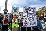 """People hold placards and banners a """"Resist and Act for Freedom"""" protest against a mandatory coronavirus vaccine, wearing masks, social distancing and the second lockdown in Trafalgar Square, London on Saturday, Sept. 26, 2020. (VXP Photo/ Vudi Xhymshiti)"""