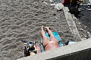male person beach sunning