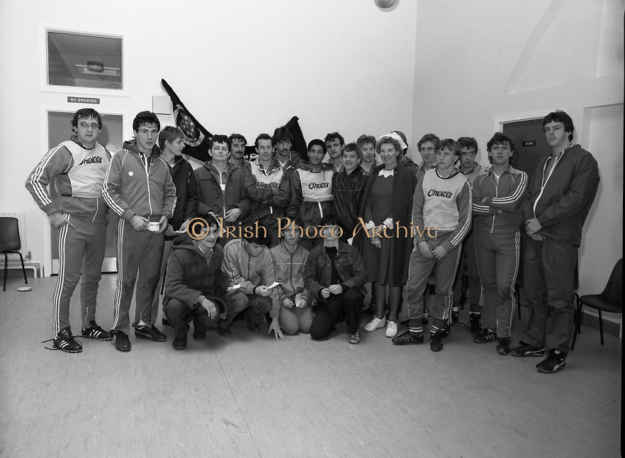 Ireland Soccer Team Training.1983.14.11.1983.11.14.1983.14th November 1983..The Ireland Soccer team trained, for the forthcoming match against Malta, at Stewarts Hospital, Palmerstown Dublin. Image of the manager, players, fans and a nursing sister from Stewarts Hospital as the line up for a group photograph.