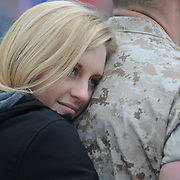 5/5/11 -- TOPSHAM, Maine. Kim Frances of Brewer hugs her U.S. Marine boyfriend, Lance Cpl. Joshua MacConnach prior to his departure.   U.S. Marine Reservists departed from Topsham on Thursday for the start of a year-long deployment to Afghanistan amidst a crowd of family, friends and well-wishers. This mission will be different from others, said several Marines, because instead of doing combat operations they will be teaching the Afghan National Army to operate independently. They travel first to California for several months of training and are planning to return in May 2012. Photo by Roger S. Duncan.
